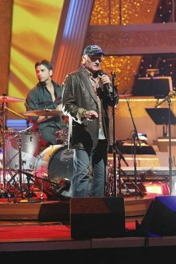 "The Beach Boys performed a medley of their hits ""California Girls,"" ""Kokomo"" and ""Fun, Fun, Fun."" Honorary band member John Stamos (""ER,"" ""Full House"") sat in with the band on guitar and drums. They were accompanied on the stage by professional ""Dancing with the Stars"" dancers Louis Van Amstel, Anna Trebunskya, Maksim Chmerkovskiy, Cheryl Burke, Damian Whitewood and Ashly Costa. The Beach Boys are led by original band member Mike Love and long time performer Bruce Johnston, along with Christian Love, Scott Totten, Randell Kirsch, John Cowsill and Tim Bonhomme. Photo: Getty Images"