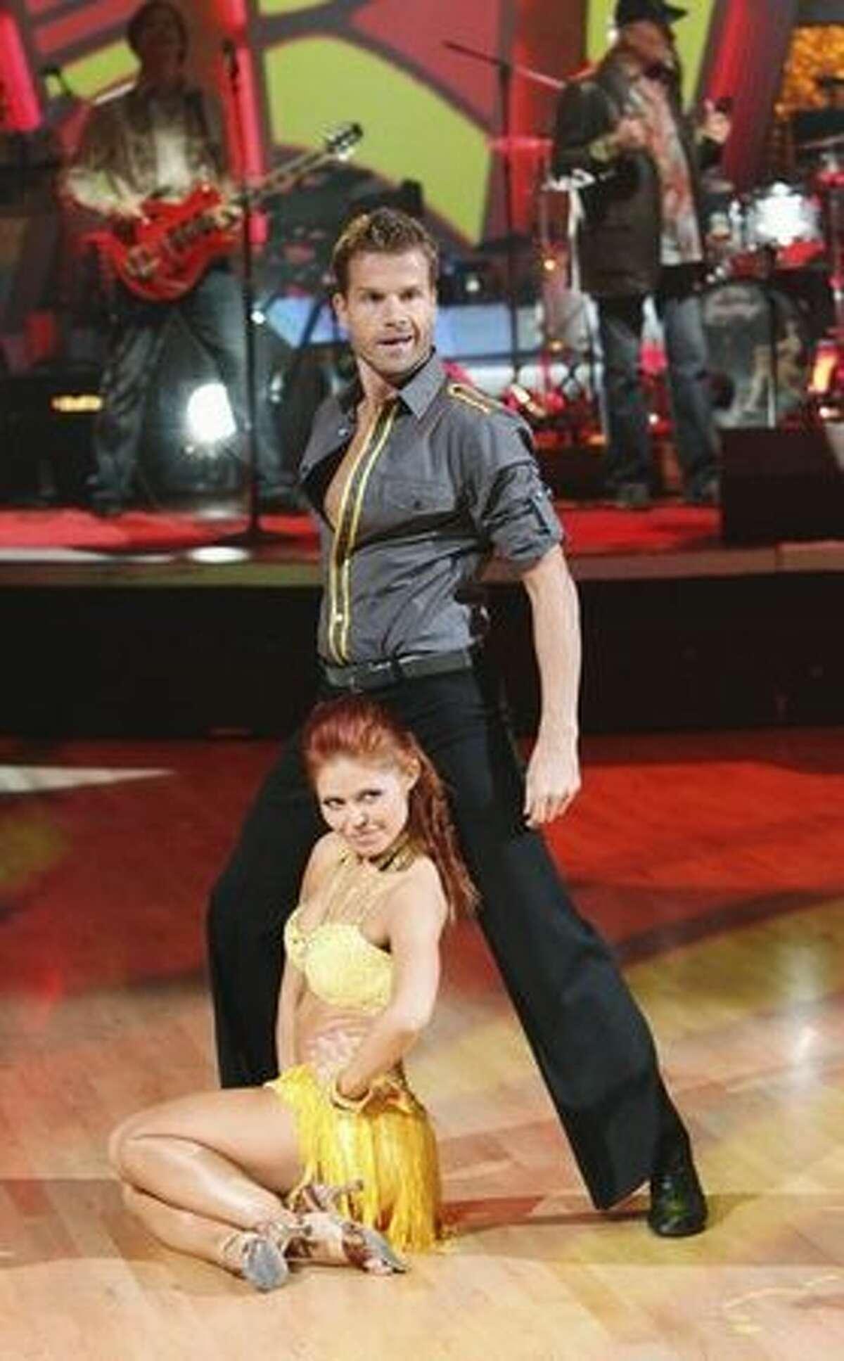 Dancers Louis Van Amstel and Anna Trebunskya perform with the Beach Boys.