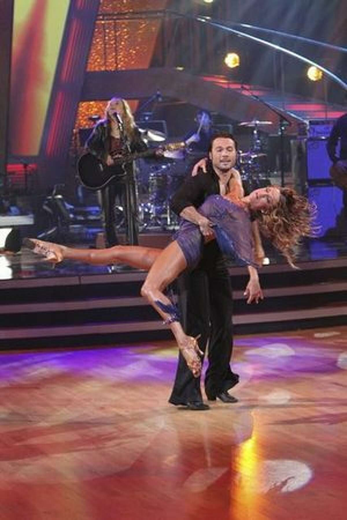 """Melissa Etheridge performs her hit """"Come to my Window,"""" accompanied on the dance floor by pros Edyta Sliwinska and Alec Mazo."""