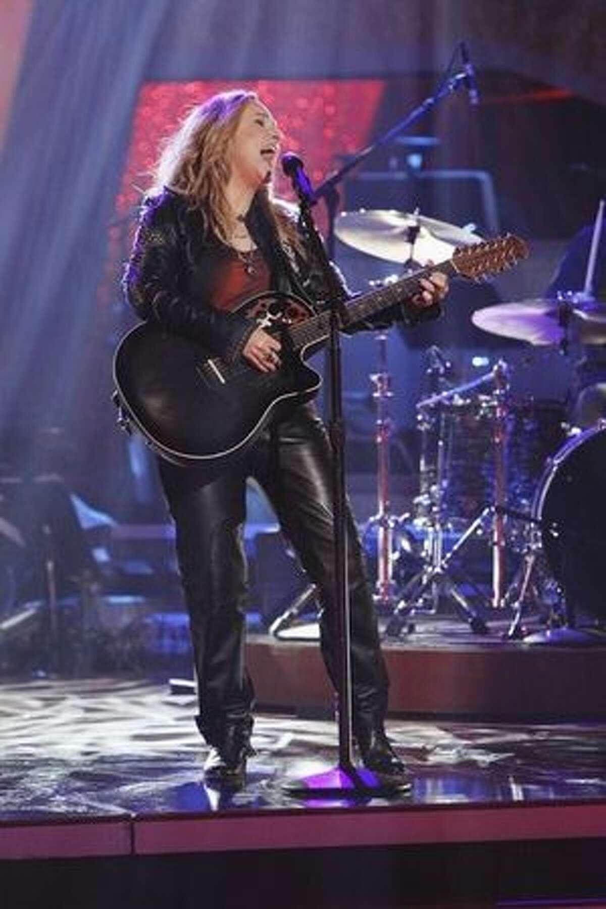 Melissa Etheridge performs.
