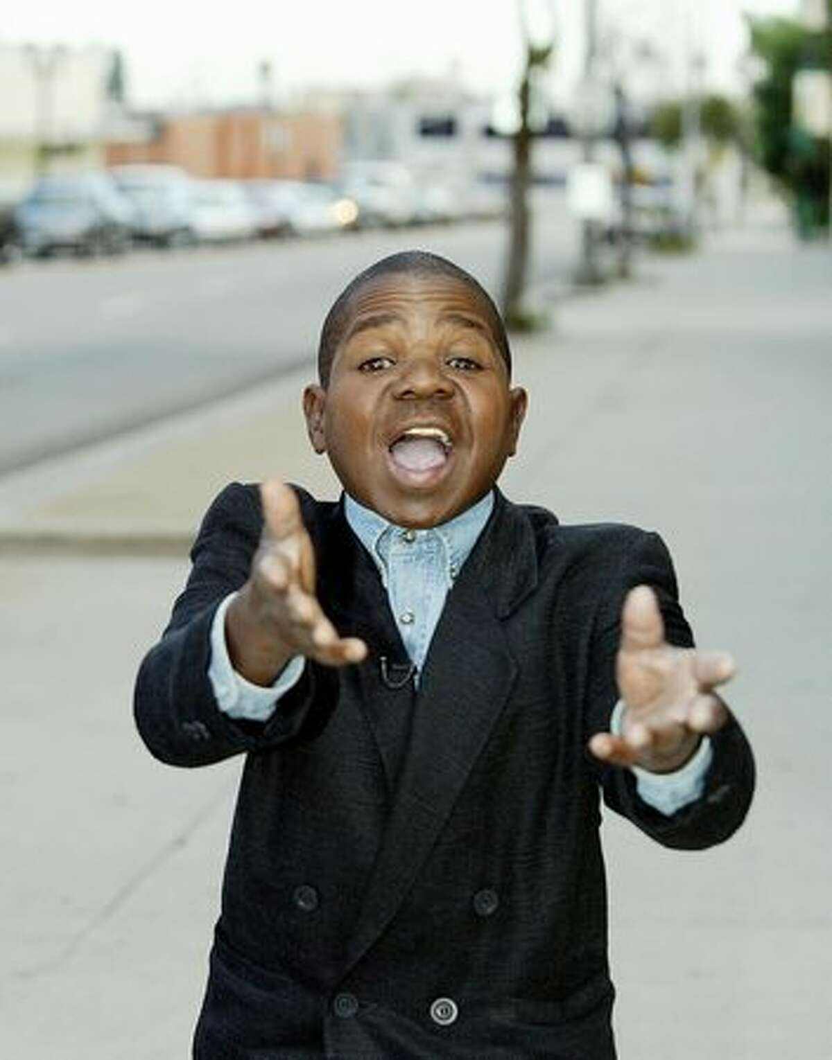 Former child actor Gary Coleman gestures on Sunset Boulevard in Los Angeles on Aug. 13, 2003. Coleman, 34, is one of more than 100 candidates in the California governor recall election.