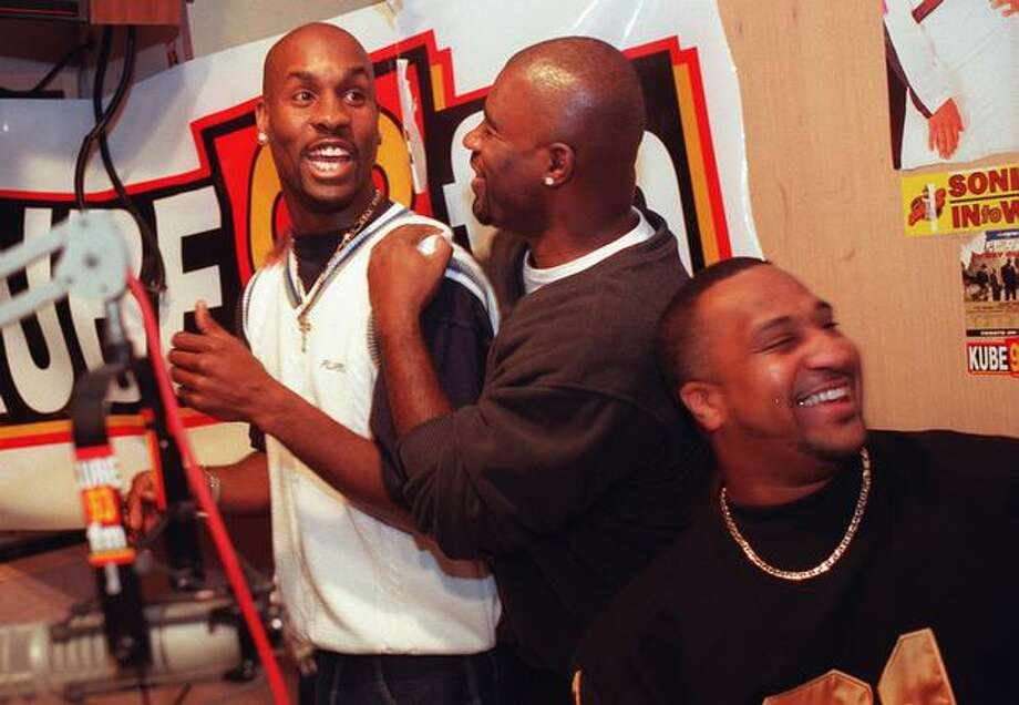 Former Seattle Supersonic Gary Payton, left, has a laugh during a KUBE FM radio show taping, December 1998. Agent Eric Goodwin is in the center and friend Trevor Pope is on the right. Photo: P-I File