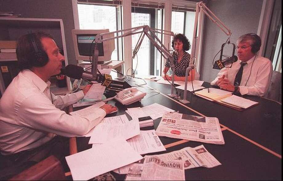 Al and Bonny Riggs, right, talk with radio talk show host Mike Siegel at KVI Radio, 1995. (Kurt  Smith/Seattlepi.com) Photo: P-I File