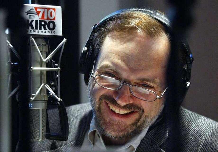 KIRO radio morning host Dave Ross smiles during a May 2004 broadcast. (Elaine Thompson/AP Photo) Photo: P-I File