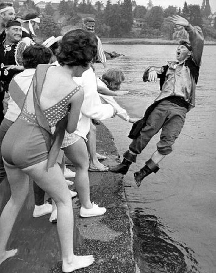 "The July 13, 2964 P-I caption read: Seafair Pirates get the ""Heave Ho"" from the Skipper Pin Girls. Photo: P-I File"
