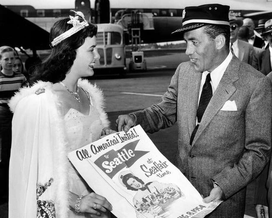 Shirley Givin Seafair Queen of the Seas, presented Ed Sullivan with the first copy of the new Seafair poster in 1954. Sullivan was a well-known newspaper man and TV personality. Photo: P-I File