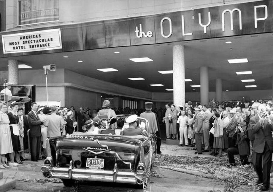 Seafair royalty driving into the entrance at the Olympic Hotel in Seattle, August 1957. Photo: P-I File