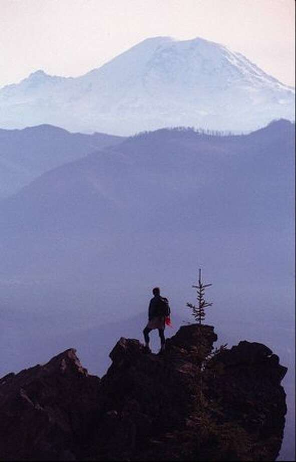 The summit of Mount Si, near North Bend, offers an excellent view of Mount Rainier on November 6, 1995. (Mike Urban/P-I) Photo: P-I File