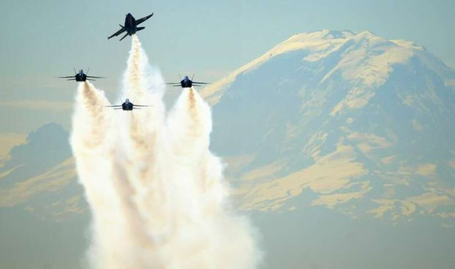 The United States Navy Blue Angels leave a smoke trail as they pass in front of Mount Rainier in Seattle on August 2, 2007. (Joshua Trujillo/P-I) Photo: P-I File