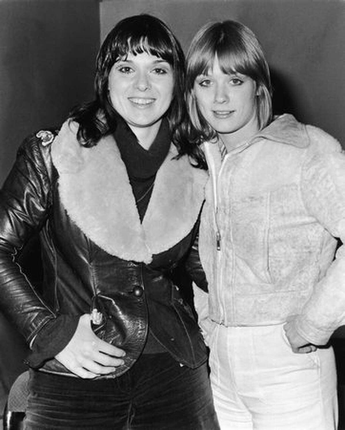 Portrait of sisters Ann and Nancy Wilson of the rock group Heart on tour in Europe, 1976.