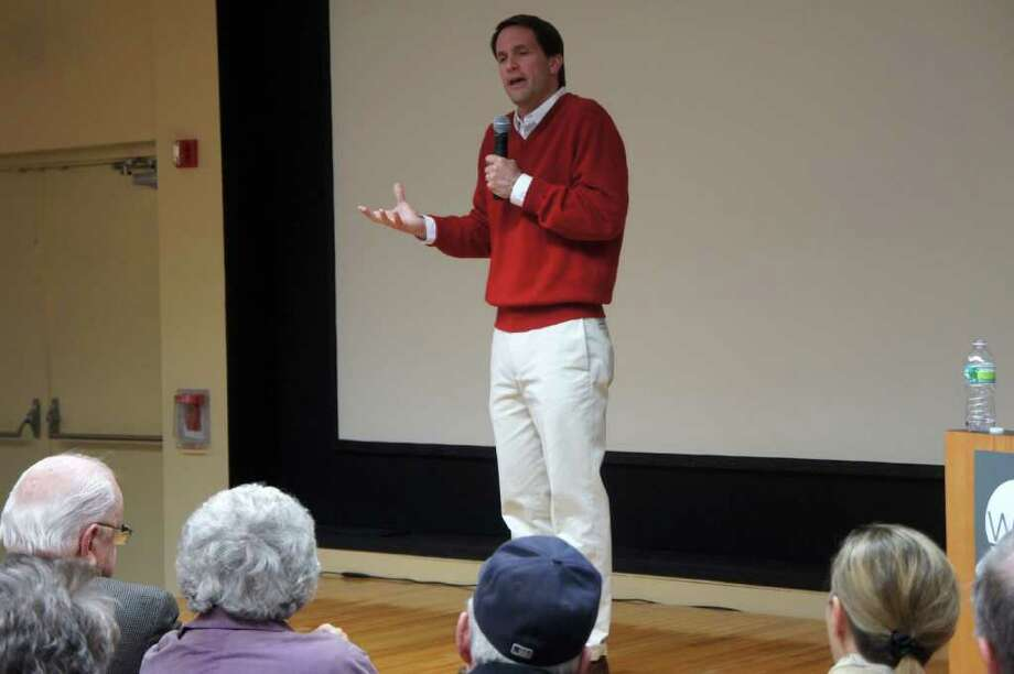 U.S. Rep. Jim Himes answers questions from constituents at a public forum Saturday in Westport. Photo: Paul Schott / Westport News