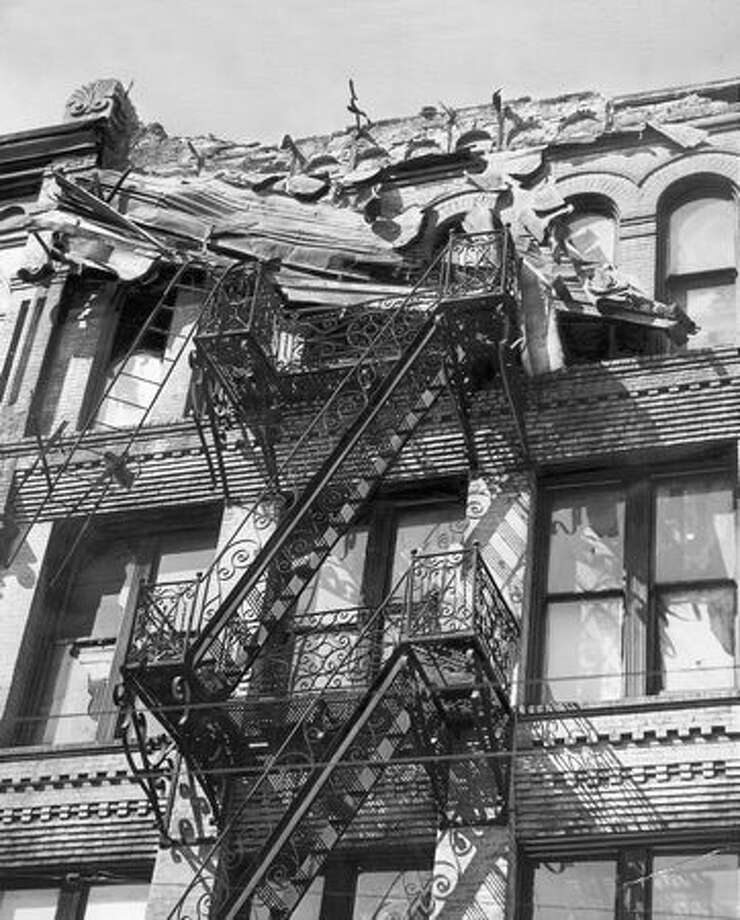 The April 13, 1949 earthquake shook a cornice loose from the Seattle Hotel at Second Avenue and James Street and dropped on a fire escape. (seattlepi.com file) Photo: P-I File