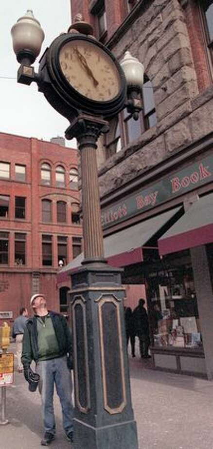 Miles Mason of Port Orchard gazes up at the stopped Elliott Bay Book Company's clock after the 6.8 earthquake rocked downtown Seattle. (Renee C. Byer/seattlepi.com file) Photo: P-I File