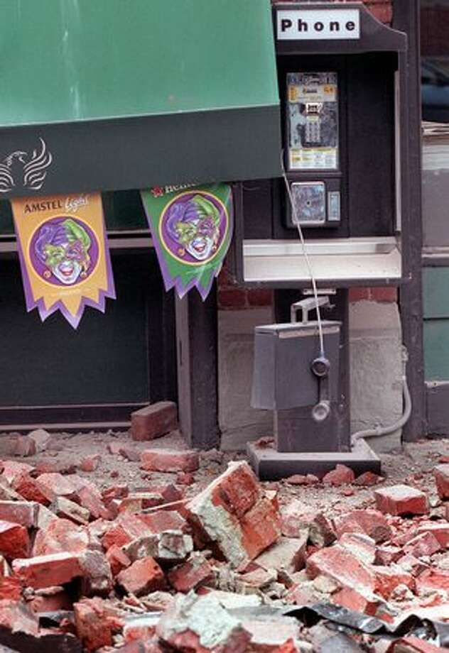 A phone hangs off the hook near the Fenix Underground after the awning collapsed during a 6.8 earthquake. (seattlepi.com file) Photo: P-I File