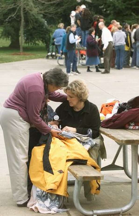 The Feb. 28, 2001 photo caption read: Vashon Island High School teacher Nancy Carr, suffering shock, is comforted by substitute teacher and former Red Cross worker Melanie Green after this morning's earthquake. Two students were also treated for shock but there were no serious injuries reported at the school. (Mike Urban/seattlepi.com file) Photo: P-I File