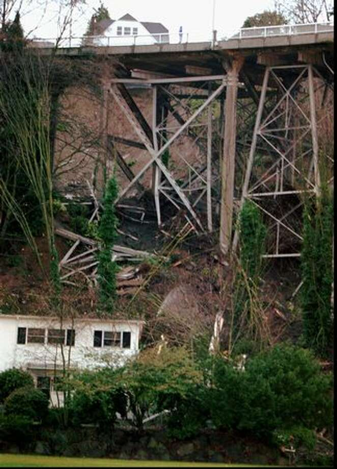 The Jan. 3, 1997 photo caption read: This is a view of secondary supports built for increased earthquake protection on the Magnolia Bridge in Seattle that was distroyed Thursday by a mud slide. The road is the main access to the Magnolia area and may be closed for some time. The mud slide also damaged the home below the bridge that is owned by the Navy. (AP Photo/Loren Callahan/seattlepi.com file) Photo: P-I File