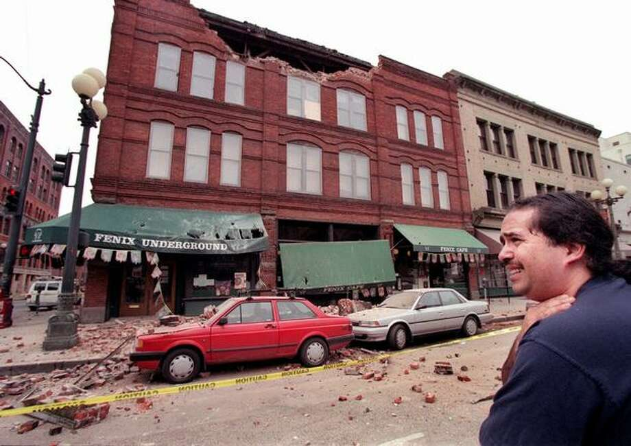 "The Feb. 28, 2001 photo caption read: David Arroya, a janitor at Fenix Underground, reacts after seeing the earthquake damage of the building at the historic Pioneer Square in Seattle. ""I hope I don't have to clean it up,"" he said. (Renee C. Byer/seattlepi.com file) Photo: P-I File"