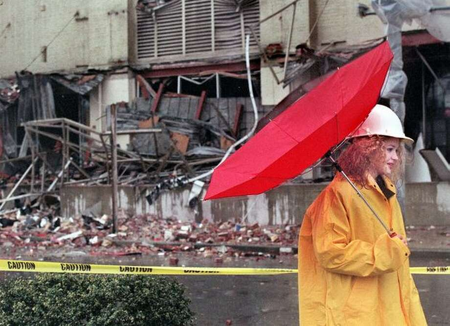 Amy Castner of Seattle works security during a windy downpour at an earthquake-damaged Sodo building in Seattle, March 1, 2001. (seattlepi.com file) Photo: P-I File