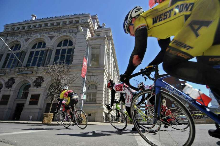 West Point cadet Gregory Keith, right, is in hot pursuit of cyclists in front of him as he turns from State Street onto 2nd Street across from the Troy Savings Bank Music Hall building during the Men's B race of the Tour de Troy on Sunday March 27, 2011 in Troy, NY.  His left elbow appears to be scraped, with his uniform torn. ( Philip Kamrass/ Times Union ) Photo: Philip Kamrass