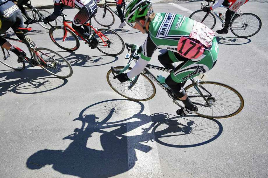 A racer casts a shadow during the Men's B race of the Tour de Troy on Sunday March 27, 2011 in Troy.   ( Philip Kamrass/ Times Union ) Photo: Philip Kamrass