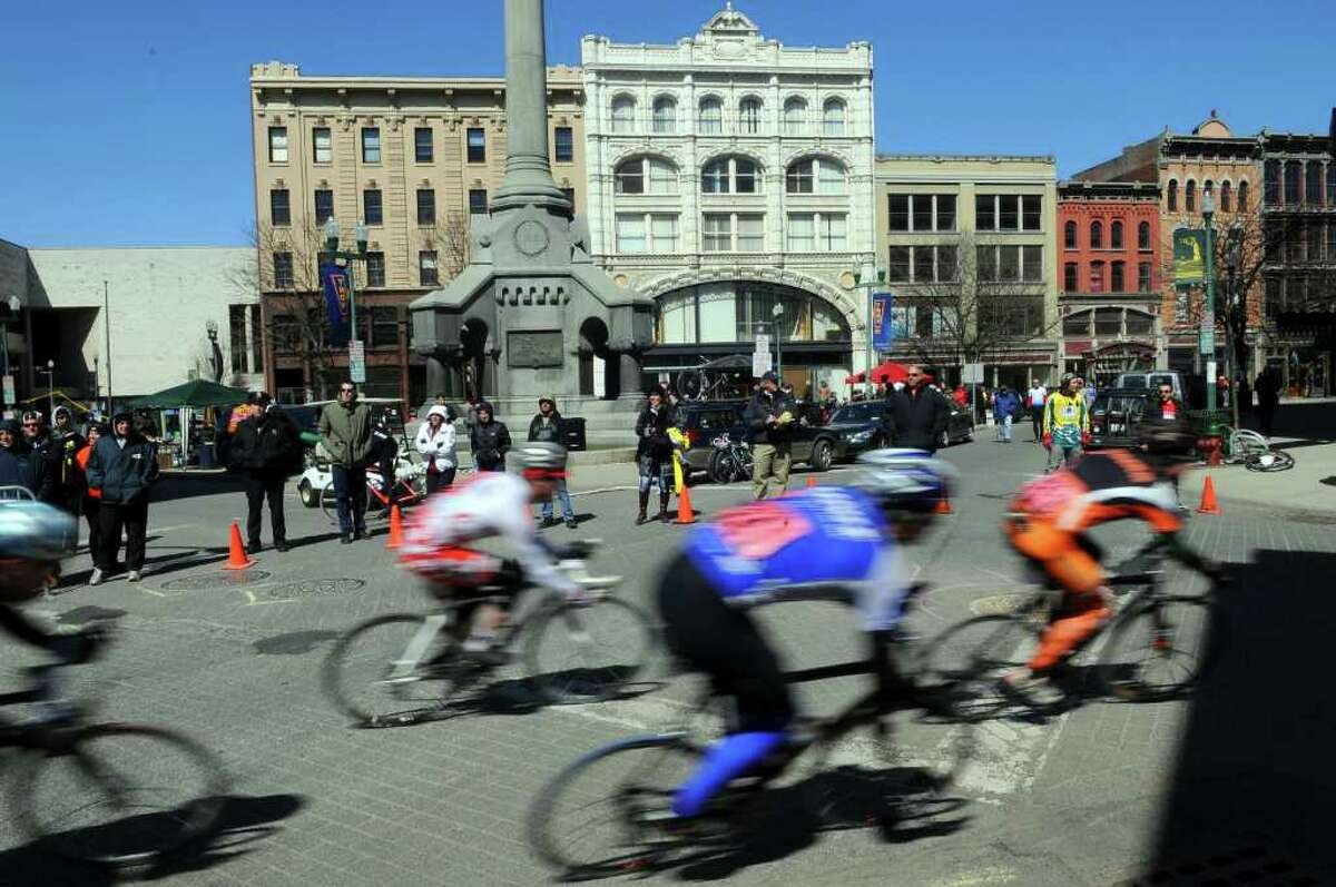 Racers head past Monument Square during the Men's B race of the Tour de Troy on Sunday March 27, 2011 in Troy. ( Philip Kamrass/ Times Union )