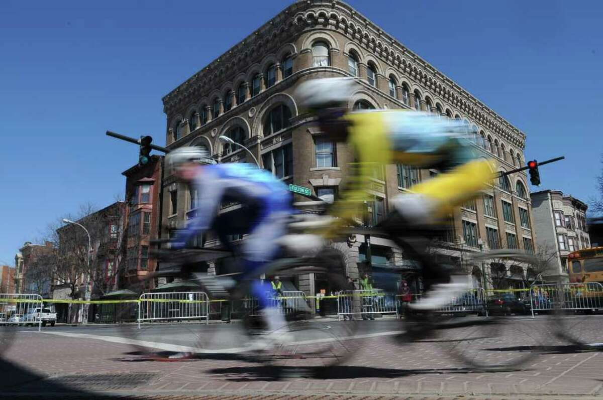 Racers turn onto Fulton Street from 4th Street during the Men's A race of the Tour de Troy on Sunday March 27, 2011 in Troy. ( Philip Kamrass/ Times Union )