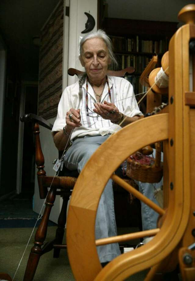 Selma Miriam, sits at one of the spinning wheels in her Westport home. Miriam was the victim of a robbery at the Bloodroot restauran, she co-owns in Bridgeport. The robber stole $100 from Miriam, a silver money box and a knitting bag. Photo: Phil Noel / Connecticut Post