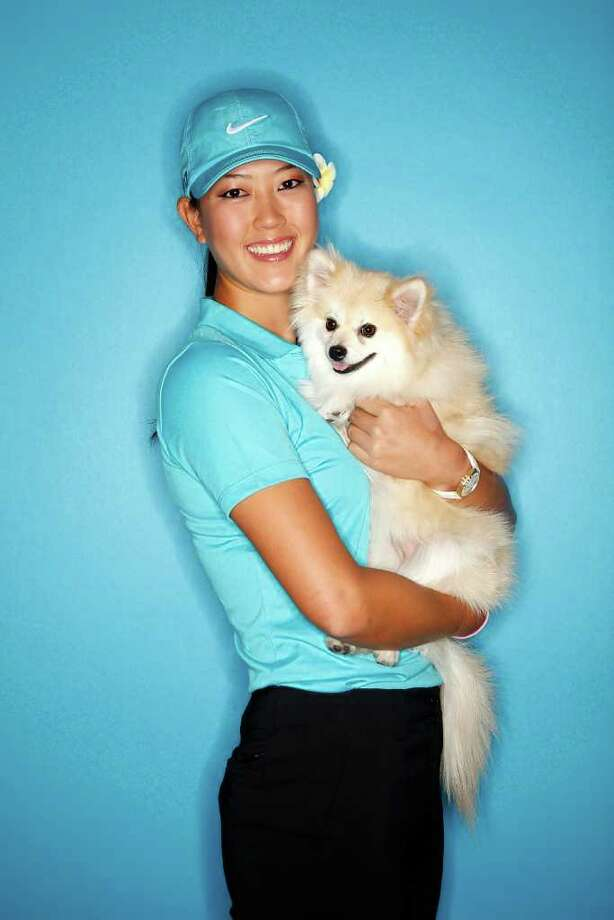 Michelle Wie poses for a portrait with her Pomeranian, Lola, at the Industry Hills Golf Club in the City of Industry, California. Photo: Jonathan Ferrey, Getty Images / 2011 Getty Images