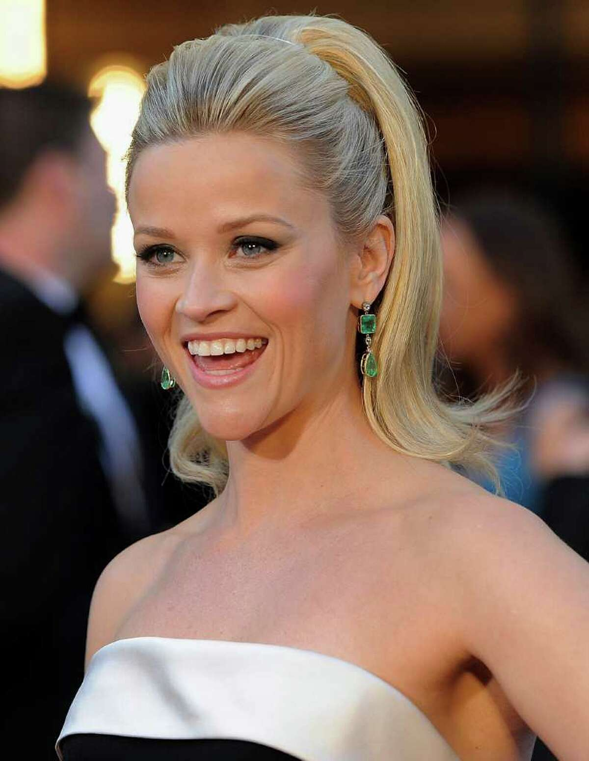 FILE - In this Feb. 27, 2011 file photo, Reese Witherspoon arrives before the 83rd Academy Awards in the Hollywood section of Los Angeles. A spokeswoman for Witherspoon says the star wed her fiance, Hollywood agent Jim Toth, Saturday, March 26, 2011 in Ojai, Calif., about 90 miles north of Los Angeles. (AP Photo/Chris Pizzello, File)