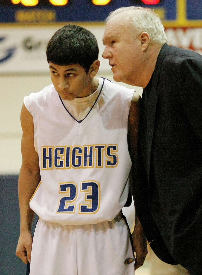 Alamo Heights head coach Charlie Boggess talks to Eddie Moreno during a game on Jan. 21, 2011.  Moreno, 18, is paralyzed from the neck down after he was shot in an alleged road rage incident in March. Photo: Darren Abate/Special To The Express-News