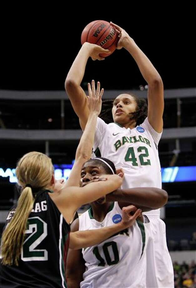 Baylor's Brittney Griner shoots as Destiny Williams screens Wisconsin-Green Bay's Kayla Tetschlag. L.M. OTERO/ASSOCIATED PRESS