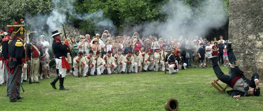 The Crossroads of Texas Living History Association re-enacts the March 27, 1836, execution of Col. James Fannin by the Mexican army. Photo: John Davenport/Express-News