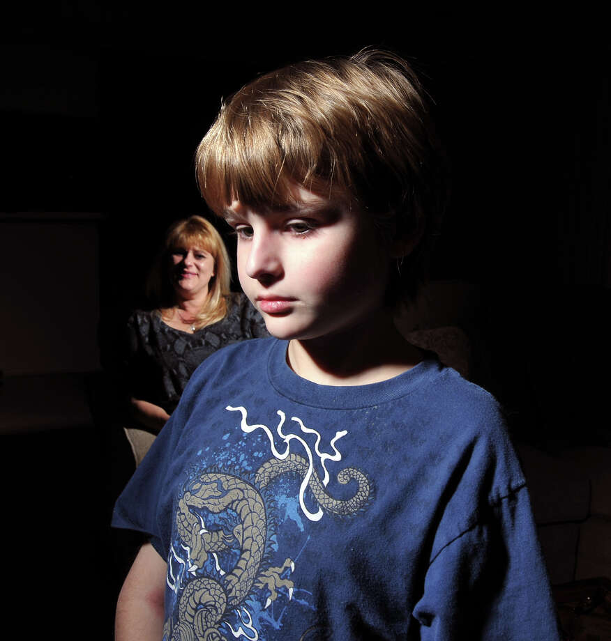 Reece Fennell, 12, used up the $10,000 in mental health benefits in the insurance of his mother, Rachel Fennell. Photo: Robin Jerstad/Special To The Express-News / Copyright 2011 by Robin Jerstad-www.JerstadPhoto.com