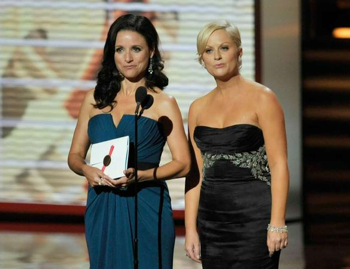 Actress Julia Louis-Dreyfus (L) and Amy Poehler present the Outstanding Supporting Actor in a Comedy Series award onstage during the 61st Primetime Emmy Awards held at the Nokia Theatre on Sunday in Los Angeles, California.