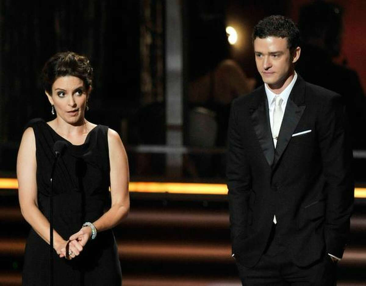 Actress Tina Fey (L) and singer Justin Timberlake speak onstage during the 61st Primetime Emmy Awards held at the Nokia Theatre on Sunday in Los Angeles, California.