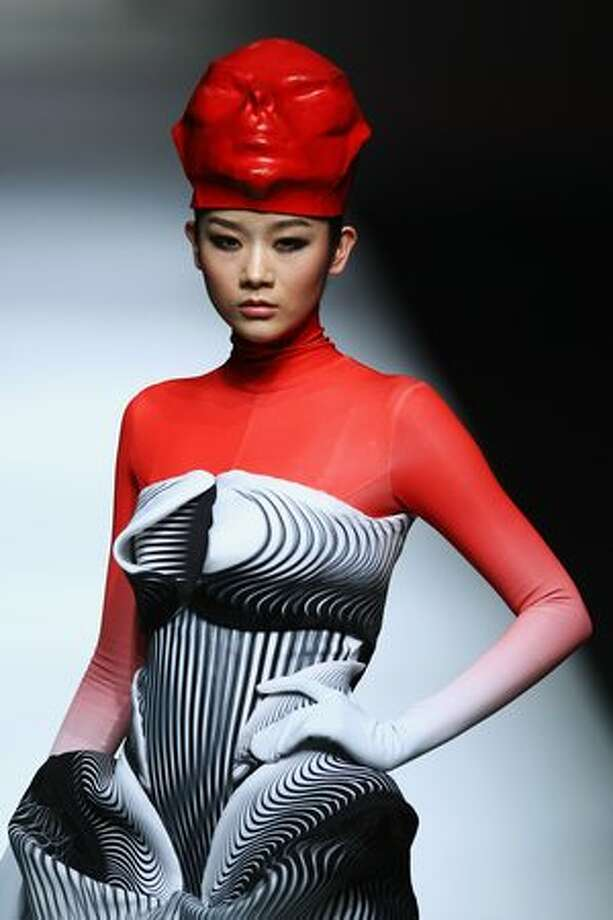 A model walks the runway during the Hempel Award 18th China International Young Fashion Designers Contest at China Fashion Week in Beijing, China. Photo: Getty Images