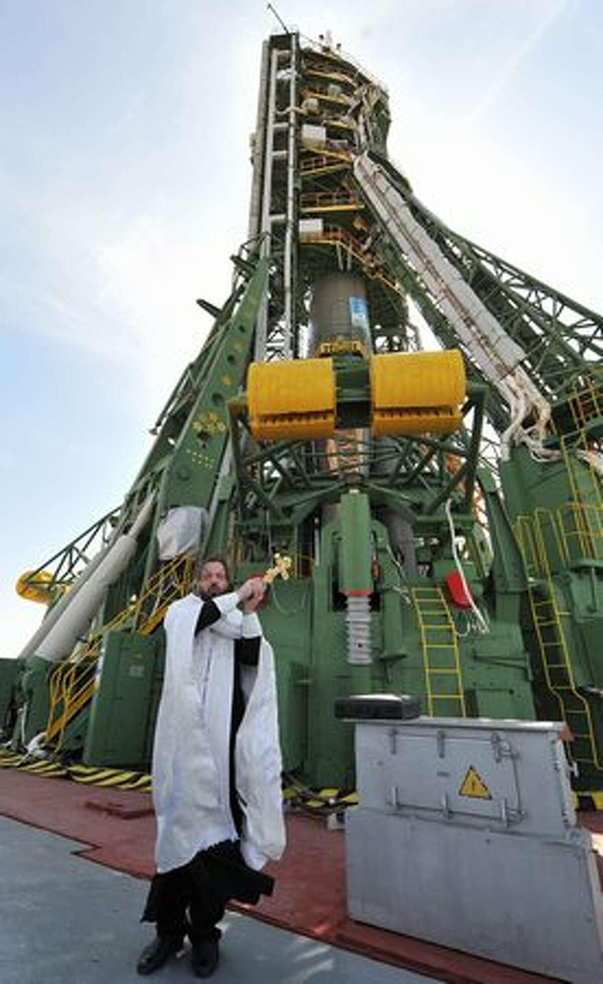 A Russian Orthodox priest blesses the Soyuz TMA-18 spacecraft at Baikonur cosmodrome, in Kazakhstan, on April 1, 2010. The crew of U.S. astronaut Tracy Caldwell Dyson, Russian cosmonaut Alexander Skvortsov and Russian cosmonaut Mikhail Kornienko are due to blast off to the International Space Station from Baikonur on April 2, 2010.
