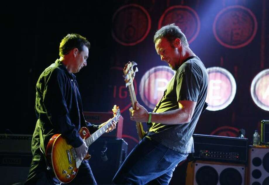 Mike McCready, left, and Jeff Ament of rock band Pearl Jam perform for a crowd at KeyArena. Photo: Joshua Trujillo, Seattlepi.com