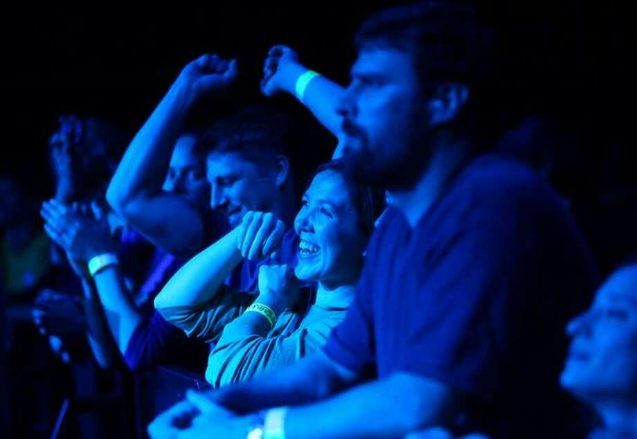 Fans watch as Seattle rock band Pearl Jam performs at KeyArena. Photo: Joshua Trujillo, Seattlepi.com