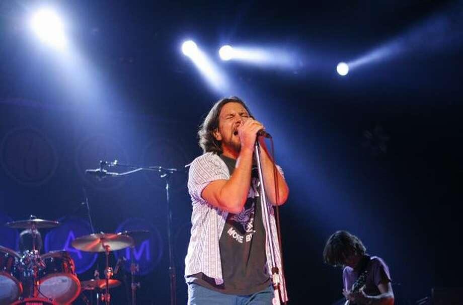 Eddie Vedder of Pearl Jam rocks KeyArena on Monday during the Seattle band's world tour kickoff. Photo: Joshua Trujillo, Seattlepi.com