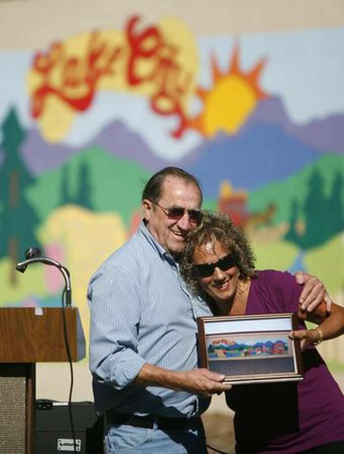 Lake City resident Chuck Dickey hugs Stephanie Tschida of the Seattle Community Court as he thanks her for helping coordinate the painting of a new Mural at Albert Davis. Community Court defendants recently painted a mural at the park. Photo: Joshua Trujillo, Seattlepi.com