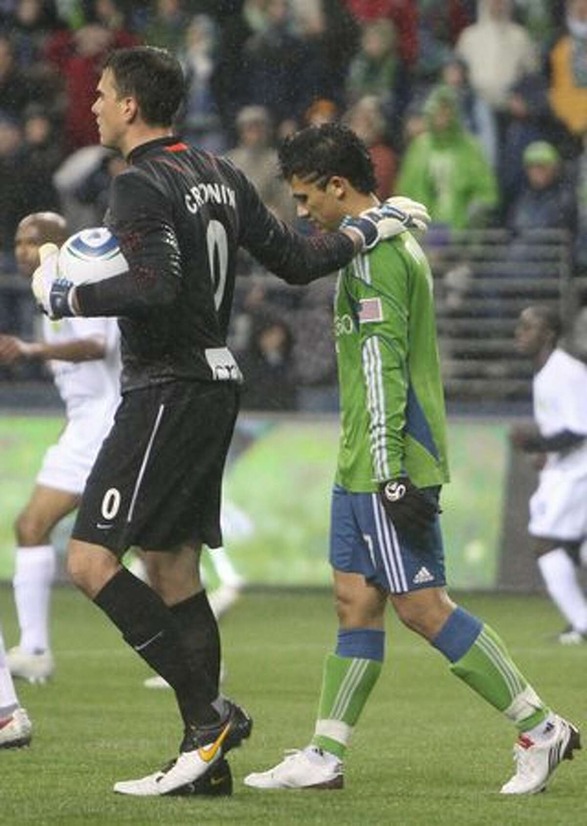After blocking his shot, Portland Timbers goalie Steve Cronin consoles Fredy Montero of the Seattle Sounders in the second half of a preseason match on March 11, 2010 at Qwest Field in Seattle.