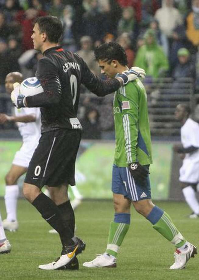 After blocking his shot, Portland Timbers goalie Steve Cronin consoles Fredy Montero of the Seattle Sounders in the second half of a preseason match on March 11, 2010 at Qwest Field in Seattle. Photo: David Ryder, Seattlepi.com