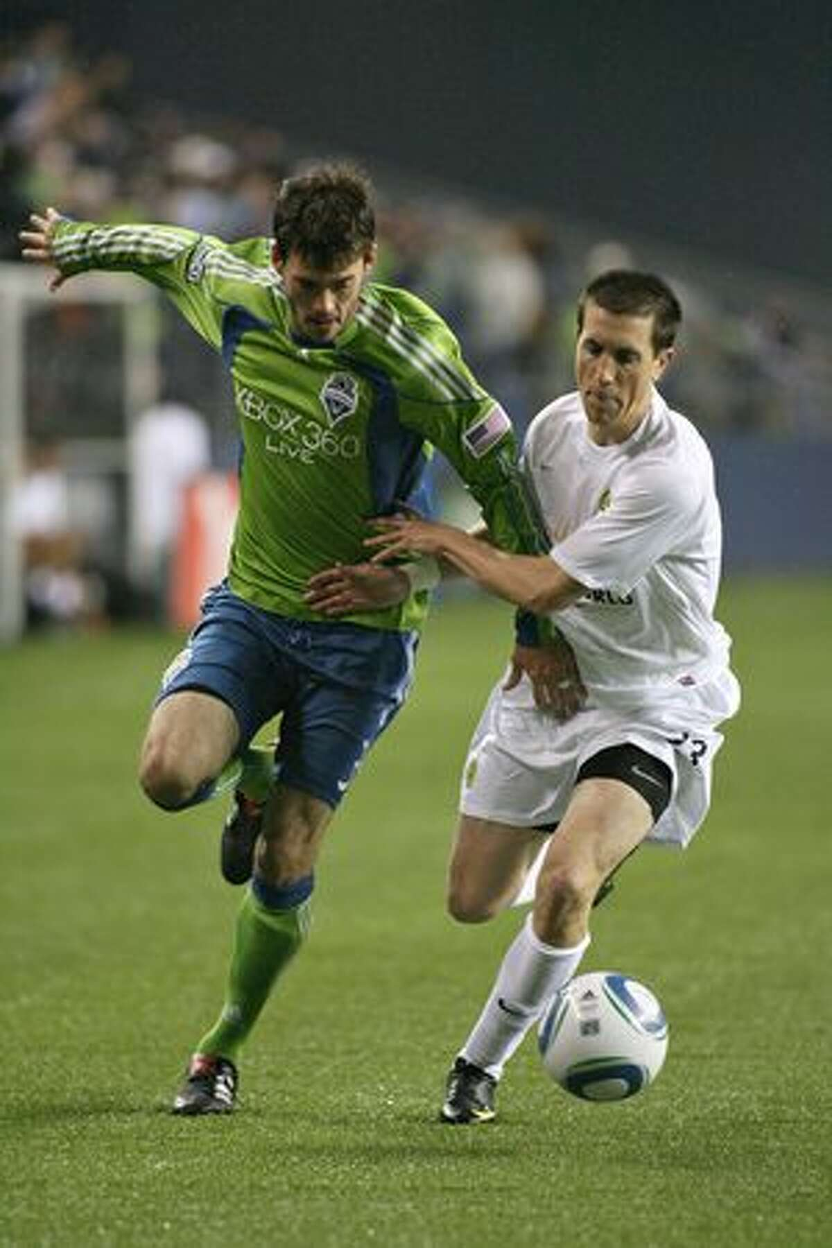 Brad Evans of the Seattle Sounders and Ryan Pore of the Portland Timbers are seen in second half action of a preseason match on March 11, 2010 at Qwest Field in Seattle.