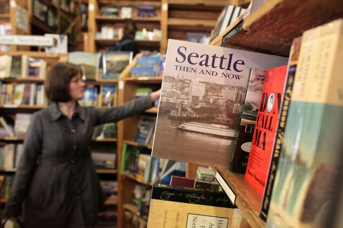 Customers browse the aisles of Elliott Bay Book Co. during the final day at the historic Pioneer Square location on Wednesday March 31, 2010 in Seattle. The legendary bookstore closed its Pioneer Square location on South Main Street Wednesday after 36 years of operation. Owners hope to open its new location at 1521 10th Ave. in Capitol Hill by April 14.