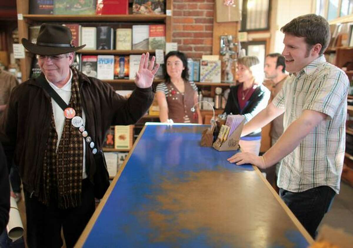 Stephen Willis, a historian for the Smith Tower, walks away from the counter after making the final purchase from Casey Stryer at Elliott Bay Book Company's Pioneer Square location on Wednesday March 31, 2010 in Seattle. The legendary bookstore closed its Pioneer Square location on South Main Street Wednesday after 36 years of operation. Owners hope to open its new location at 1521 10th Ave. in Capitol Hill by April 14.