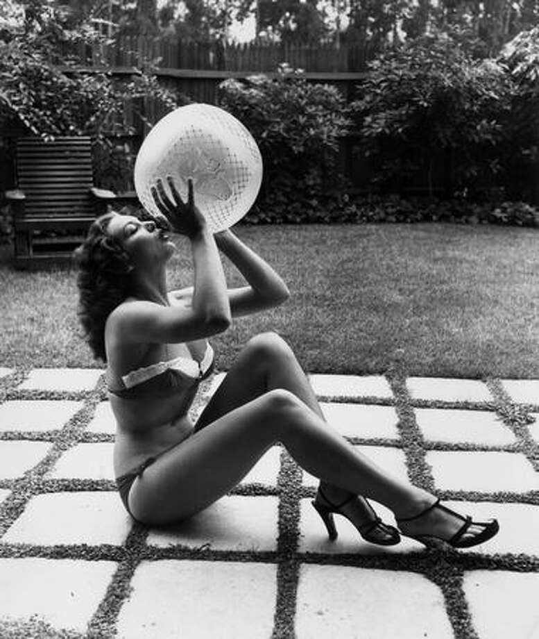Circa 1955: American burlesque performer Blaze Starr, wearing a bikini and high heels. The bikini seems interesting enough, but somehow it became de rigeur to add high heels and some sort of ball. Photo: Getty Images