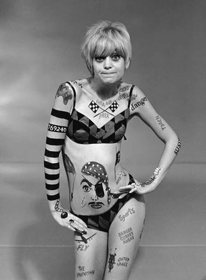 "1968: Goldie Hawn rockets to fame wearing body paint and a bikini in the hit television series, ""Laugh-In."" Photo: Getty Images"