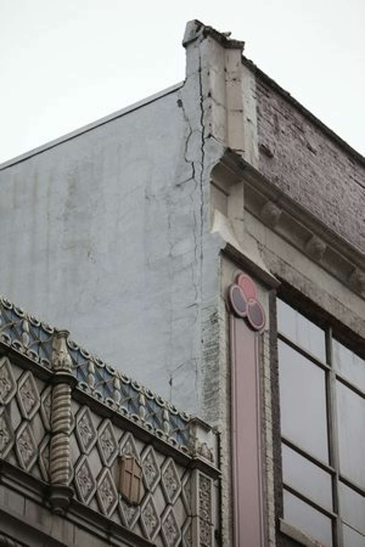 A section of facade is cracked after part of of the Icon Grill building came crashing down onto the street on Friday at the intersection of 5th Avenue and Virgina in Seattle.