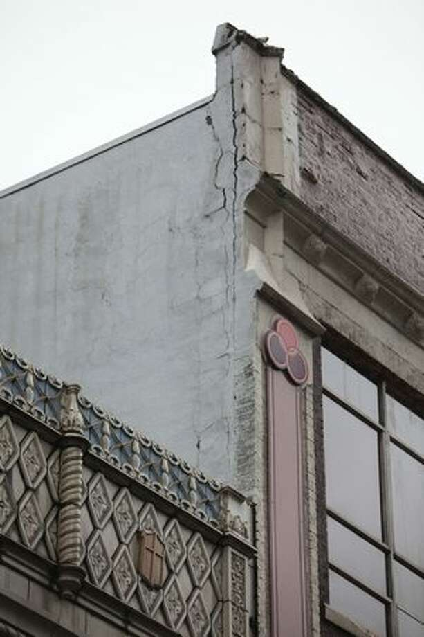 A section of facade is cracked after part of of the Icon Grill building came crashing down onto the street on Friday at the intersection of 5th Avenue and Virgina in Seattle. Photo: Joshua Trujillo, Seattlepi.com